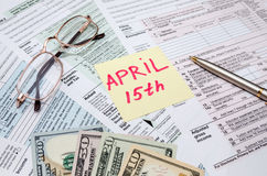 Official USA tax form 1040, calculator, pen and dollar and the day tax april Royalty Free Stock Photo