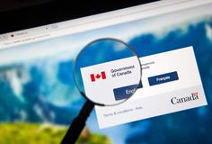 Official web page of Canadian Government. MONTREAL, CANADA - NOVEMBER 17, 2017: Official web page of Canadian Government under magnifying glass where every user Stock Image