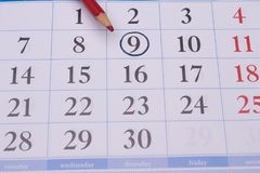 Calendar with a red pencil and with black circle Stock Photo