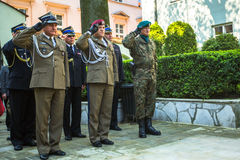Officials at ceremony of laying flowers to the monument to Hugo Kollataj during annual Polish national and public holiday Royalty Free Stock Photo