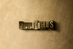 OFFICIALS - close-up of grungy vintage typeset word on metal backdrop Stock Image