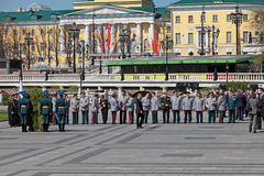 Officials and generals. MOSCOW - MAY 8: Officials and generals gathered in the Alexander garden to lay flowers and wreaths to the monument Tomb of the Unknown Stock Photo