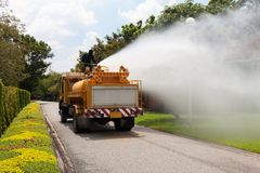 Officials are spraying water from the atomizer. On large water truck outdoor Stock Photo