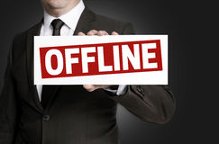 Offline sign is held by businessman Stock Image