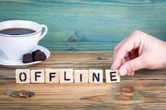 Offline. Wooden letters on the office desk, informative and communication background.  royalty free stock photography