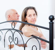 Offoffended woman sitting  next to    man. Stock Photography