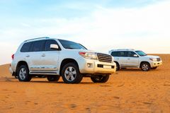 Offroad arabian desert safari in Dubai, UAE. Dune bashing. Golden hour.  stock photos