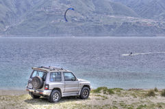 Offroad on the beach and kitesurf on the sea Stock Photo