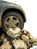 Offroad car. And stones, with mud on an isolated white background Stock Image
