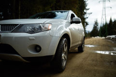 Offroad car on country road Stock Image