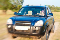 Offroad car drive with woman. Offroad summer field car drive with woman steering Royalty Free Stock Images
