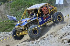 Offroad Car Drove Fast. Adrenaline sports offroad cars drove across tracks in a competition stock photo