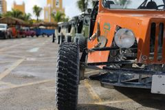 Offroad car in focus and blur cars at back. 4 wheel drive buggy car parked for rent in the port Costa Maya Royalty Free Stock Images