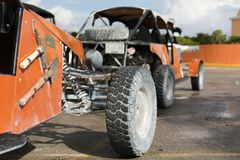 Offroad car in focus and blur cars at back. 4 wheel drive buggy car parked for rent in the port Costa Maya Royalty Free Stock Image