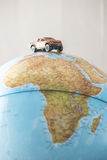 Offroad car on globe. Miniature concept Royalty Free Stock Photos