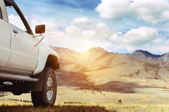 Offroad car jeep mountains 4x4. SUV car against mountains. 4x4 offroad concept. Space for text royalty free stock photos