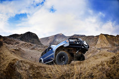 Offroad car on mountain road Royalty Free Stock Photo