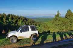 Offroad car on the mountains. Offroad car and people`s shadow on the mountains Royalty Free Stock Photo