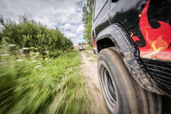 Offroad car moving with high speed Royalty Free Stock Image