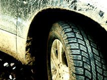 Offroad car with mud. Tire detail of an offroad car covered with mud Royalty Free Stock Image