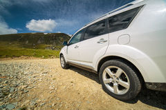 Offroad car near the mountains Stock Photography