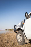 Offroad car at the river Stock Image