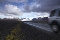 Offroad car on a straight road from the mountains Royalty Free Stock Photography