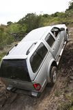 Offroad Driving. An offroad 4x4 vehicle negotiang a steep climb Royalty Free Stock Images
