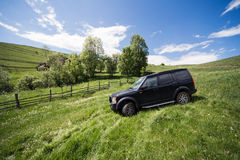 Offroad driving. Black Land Rover Discovery taken out for offroad driving. Picture taken in a green landscape during spring Stock Images