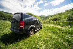 Offroad driving. Black Land Rover Discovery taken out for offroad driving. Picture taken in a green landscape during spring Stock Photos