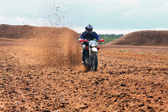 Offroad motorbike driving in dirt. Royalty Free Stock Images