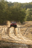 Offroad race. Red jeep (car) on sand read; off-road race Stock Photos