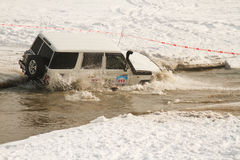 Offroad race car in the river of winter season Stock Photography