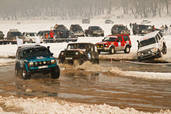 Offroad race cars in the river on road racing Stock Images