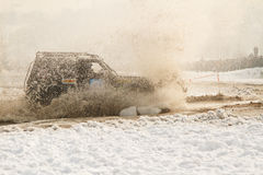 Offroad race cars in the river on road racing Stock Photos