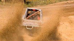 Offroad racing. Buggy in the mud from back Royalty Free Stock Photos