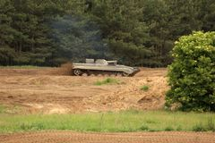 Offroad scenery with driving tank Stock Photos