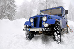 Offroad 4x4 in the snow. Blue Offroad 4x4 in the snow stock photos
