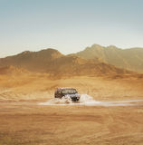 Offroad SUV riding in the desert Royalty Free Stock Images
