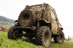 Offroad vehicle. Offroad car 4x4 all wheel drive covered in mud, outdoor Stock Photos
