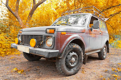 Offroad vehicle in autumn forest Royalty Free Stock Photo