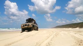 Offroad vehicle at the beach. 4x4 Offroad vehicle drives at the beach stock photo