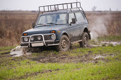 Offroad vehicle in countryside Stock Photos