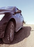 Offroad. Vehicle on a dirt road Stock Images