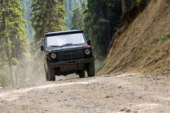 Offroad 4x4 vehicle. Driving on a forest dirt path Stock Photo
