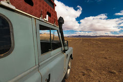 Offroad vehicle oldtimer driving off road in Morocco Stock Photo