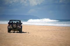 Offroad Vehicle on a Remote Beach in Hawaii Stock Image