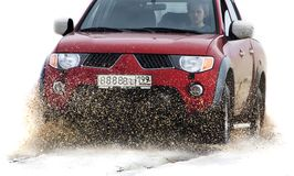 Offroad vehicle running through mud Royalty Free Stock Photography