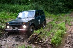 Offroad in wilds. Expedition after hills local car Stock Photos