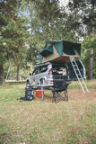 Offroad 4x4 vehicle with tent in roof ready for camping Stock Image